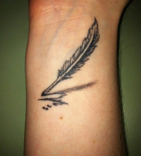 Simple feather pen arm tattoo