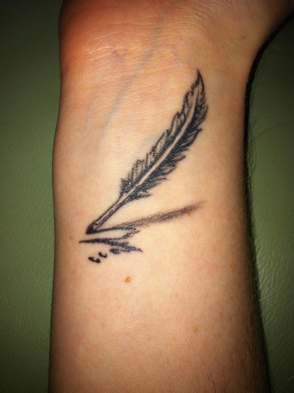 Simple feather pen arm tattoo - | TattooMagz › Tattoo ...
