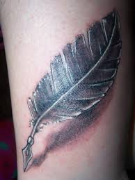 Simple feather pen tattoo