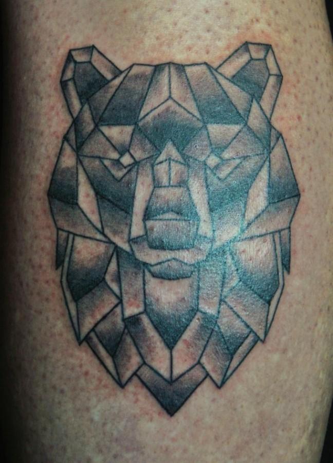 Simple geometrical bear tattoo