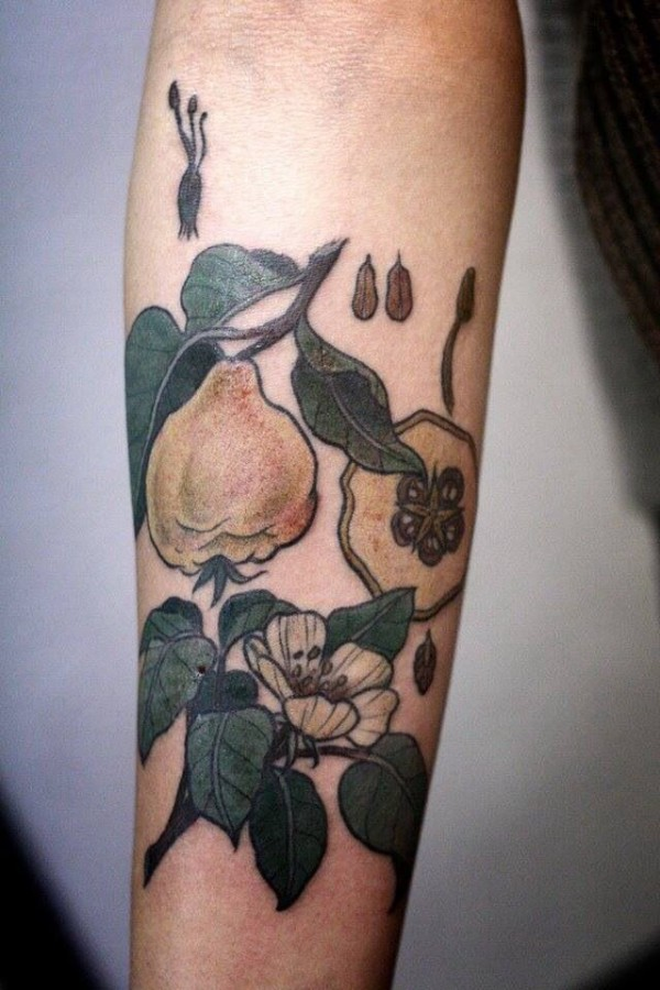 Simple green fruit tattoo