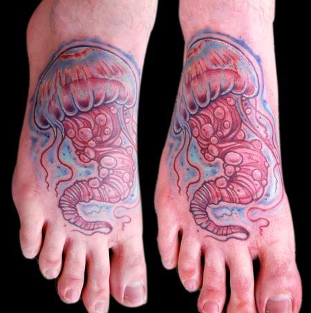 Simple jellyfish foot tattoo