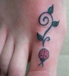 Simple ladybug foot tattoo