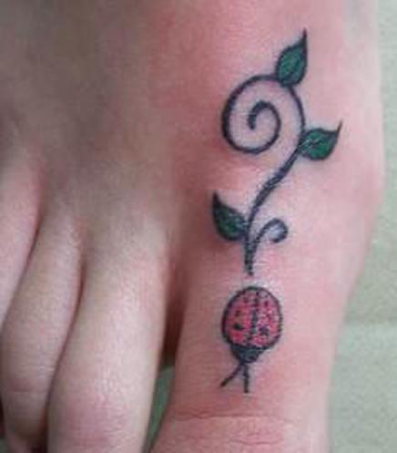 Simple ladybug foot tattoo