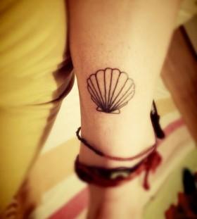 Simple shell arm tattoo