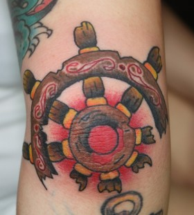 Simple ship's wheel tattoo