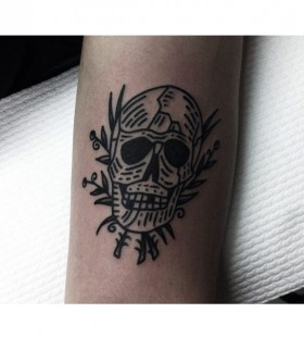 Simple skull tattoo by Charley Gerardin