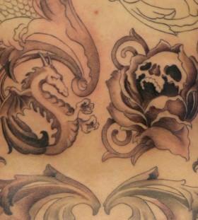 Skeleton and dragon tattoo