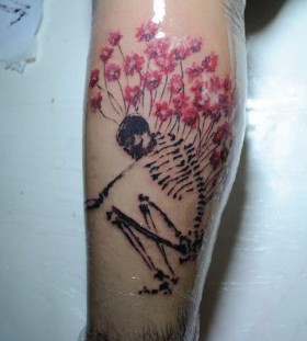 Skeleton and flowers tattoo by Tyago Compiani