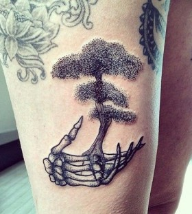 Skeleton hand and tree tattoo by Rebecca Vincent