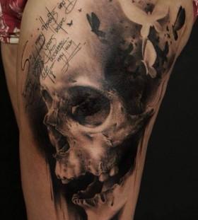 Skull and birds leg tattoo by Florian Karg