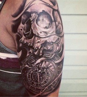 Skull and clock arm tattoo
