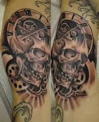 Skull and clock tattoo