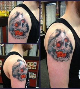 Skull and dragon ball tattoo