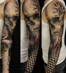 Skull and eye full arm tattoo