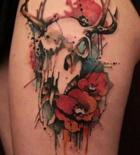 Skull and flower watercolor tattoo