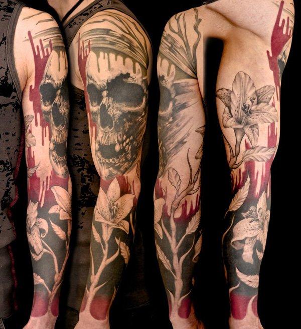 Skull and flowers full arm tattoo