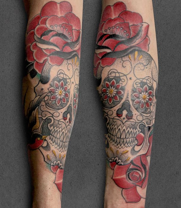 Skull and flowers tattoo by Pepe Vicio