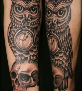 Skull and owl with clock tattoo