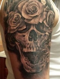 Skull and roses arm tattoo by Razvan Popescu
