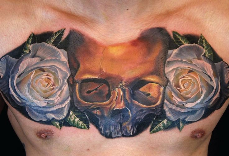 Skull and roses chest tattoo by Phil Garcia