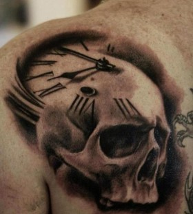 Skull clock back shoulder tattoo