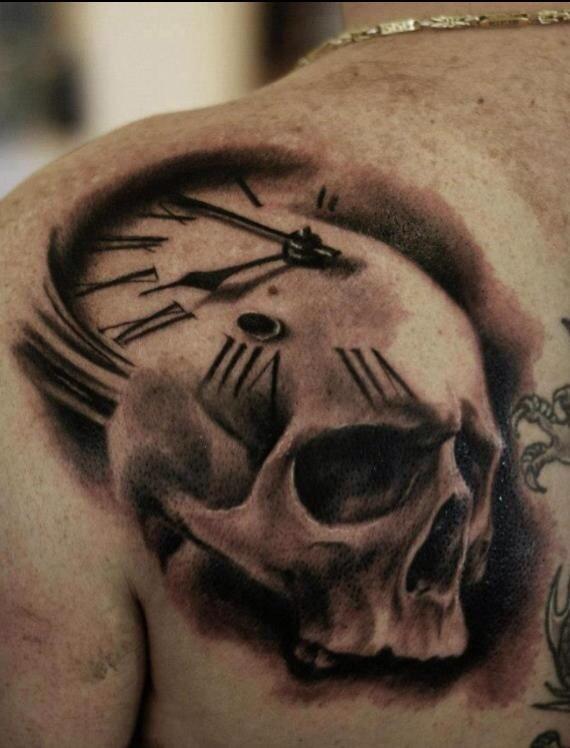 Skull clock back shoulder tattoo