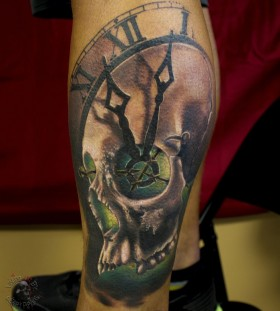 Skull clock leg tattoo
