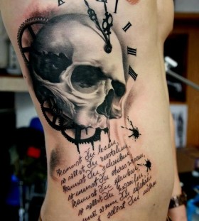 Skull clock side tattoo