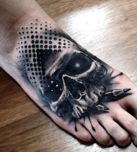 Skull foot tattoo by Benjamin Laukis