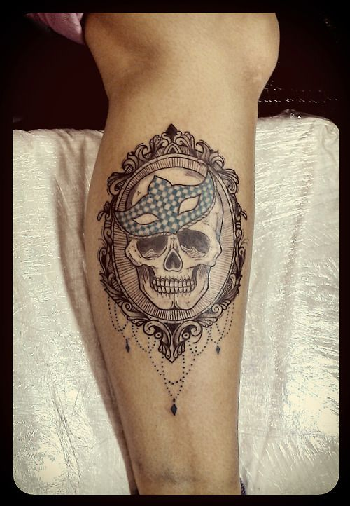 Skull in a frame tattoo by Tyago Compiani