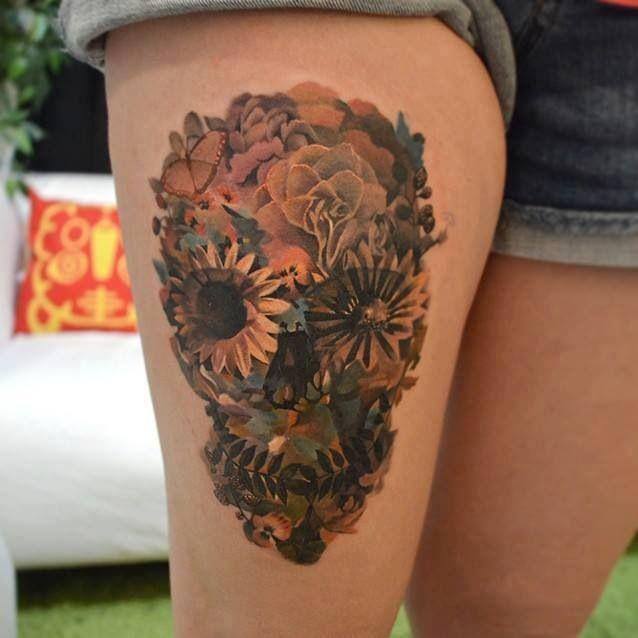 Skull of flowers leg tattoo