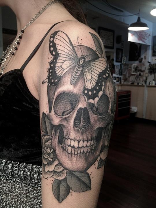 Skull rose and moth tattoo