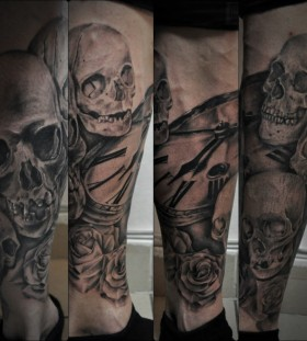 Skulls and clock tattoo