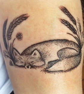 Sleeping fox tattoo by Rebecca Vincent