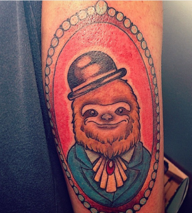 Sloth with a hat tattoo