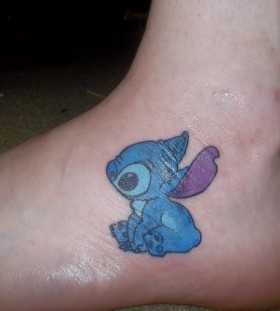Small Stitch foot tattoo
