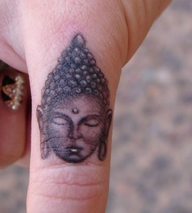 Small buddha finger tattoo