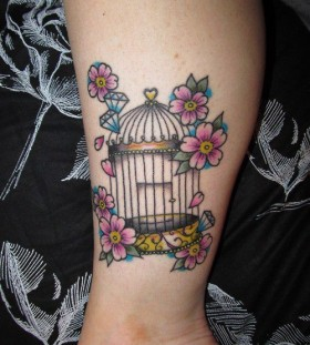 Small coloured birdcage and flowers tattoo