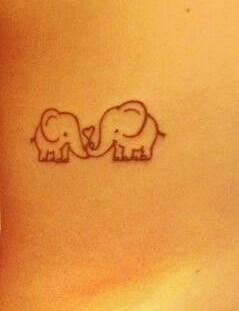 Small elephants family love tattoo