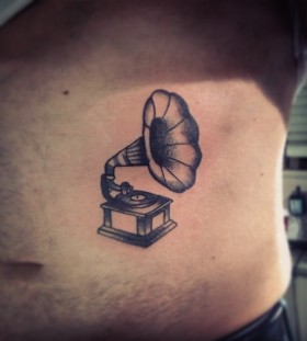 Small gramophone stomach tattoo
