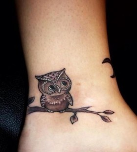 Small owl ankle tattoo