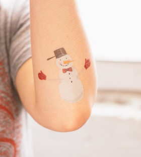 Small snowman arm tattoo