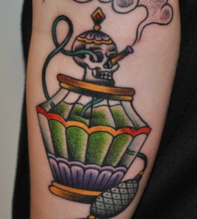 Smoking skull perfume bottle tattoo