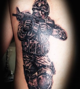 Soldier with a gun tattoo