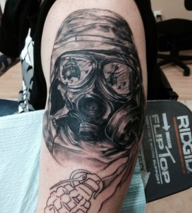 Soldier with gas mask tattoo