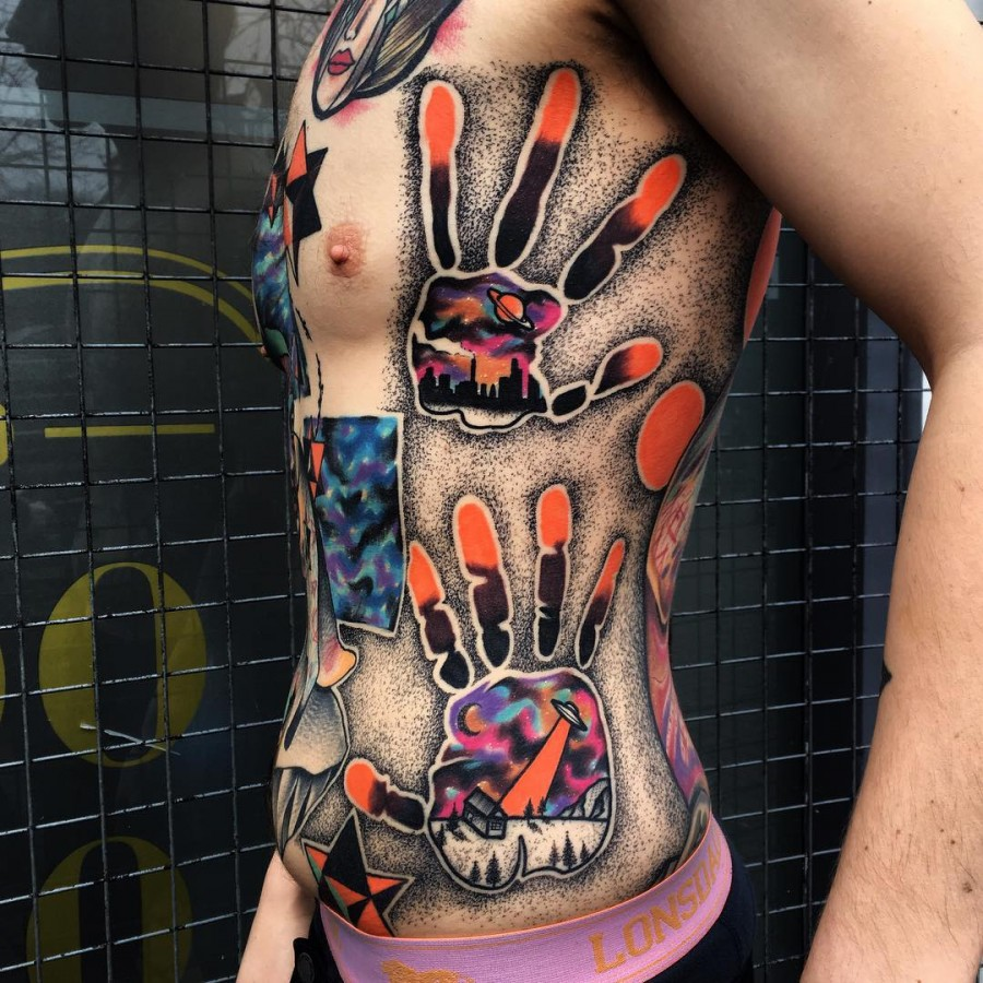 space handprint tattoo by littleandytattoo