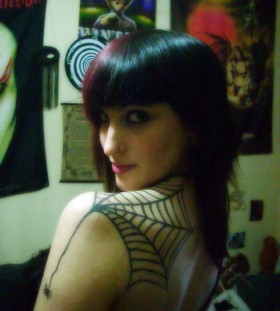 Spider web back tattoo