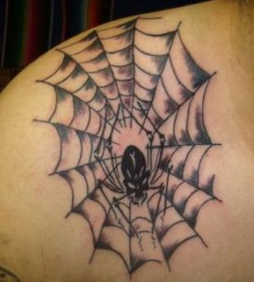 Spider web shoulder tattoo