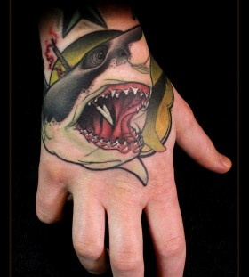 Stabbed shark hand tattoo